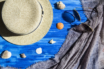 Sea and vacation concept with hat and seashells