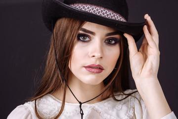 Portrait of a beautiful woman in cowboy's hat