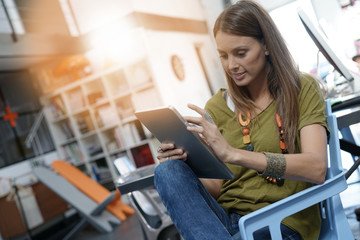 Woman in office working on digital tablet
