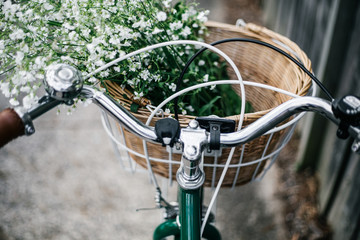 Bicycle basket filled with flowers