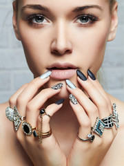 beautiful woman face and hands with jewelry