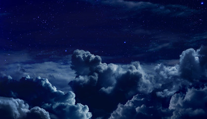 beautiful starry night sky with large clouds Fototapete