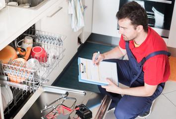 Worker estimating cost for broken dishwasher