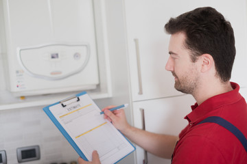 Plumber  control check on the home water boiler