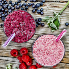 Healthy eating. Refreshing fruit cocktail with scattered berries. View from above