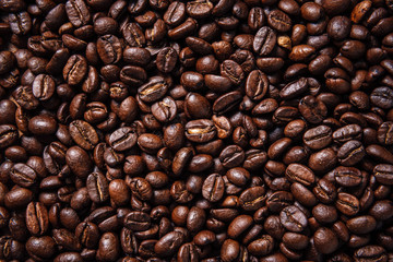 Texture of roasted ready to drink coffee close-up.Coffee Bean Scene.BlackGround Coffee.