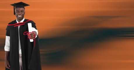 Graduate man smiling against blurry orange abstract background