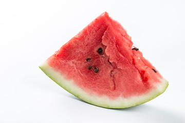 Slice of watermelon isolated over white background