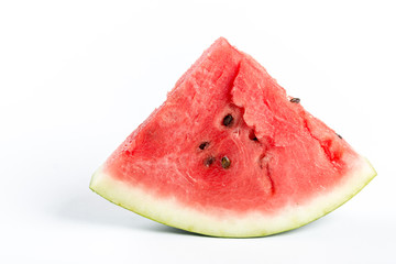 Slices of watermelon isolated above white background
