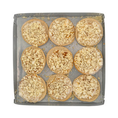 Top view of frozen mini cheese pizza bagels on a microwavable tray isolated on a white background.