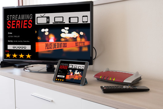 Smart tv and digital tablet connected to internet modem
