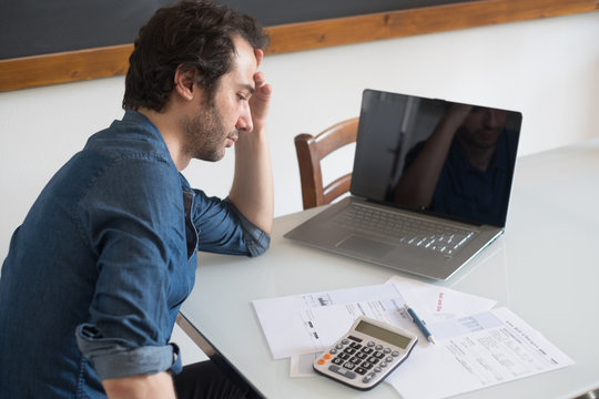 Desperate man trying to find solution for taxes and bills