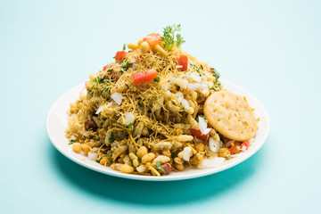 Bhel Puri - Popular Mumbai street food served with coriander and tamarind chutney on white background, selective focus