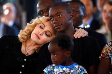 US singer Madonna embraces her son, David Banda ahead of the opening of the Mercy James hospital in Blantyre