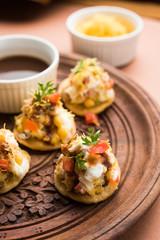 Sev Btata Puri / sev puri / papdi chat - popular indian snacks item  - Indian street food, selective focus