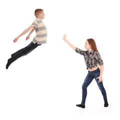 Girl keeps the boy in will in the air. Levitation with the power of thought.