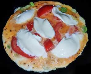 Omelet with Mozzarella nd tomatos