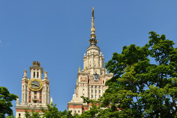 Lomonosov Moscow State University. Spiers among trees, summer city landscape. It was built in 1953e
