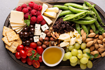 Cheese plate with fresh vegetables and fruits