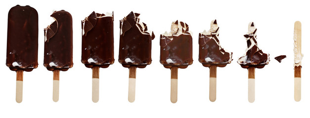 Progression of chocolate covered vanilla ice cream bars on a wooden stick with bites taken out. Isolated over a white background.