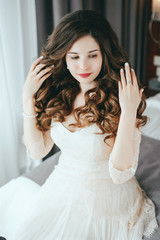 Luxury stylish bride sitting on the bed
