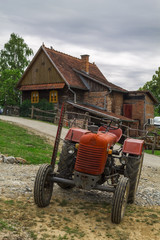 Rustic tractor and house
