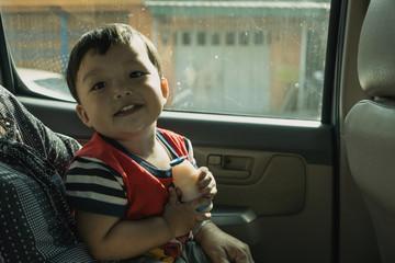 Little boy enjoy travel. Inside of a car