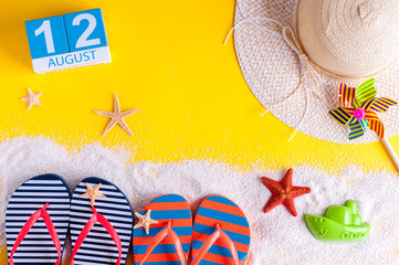 August 12th. Image of august 12 calendar with summer beach accessories and traveler outfit on background. Summer day, Vacation concept
