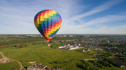 Rainbow aerostat over village aerial view