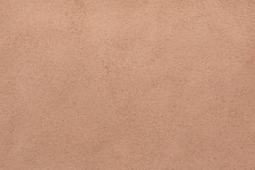 Brown painted stucco wall. Background texture
