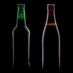 green and brown bottles of beer, on a black background, with brilliant edges and foam