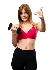 Beautiful sport woman with dumbbells doing coming gesture