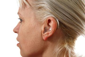 digital hearing aid in woman's ear