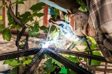 Man welding at his backyard