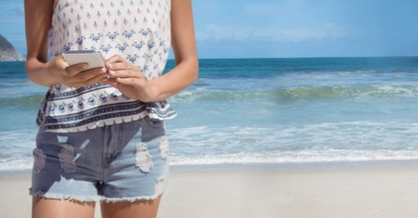Woman mid section summer clothes against beach