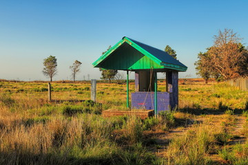 Abandoned ticket booth at an old drive in movie theater
