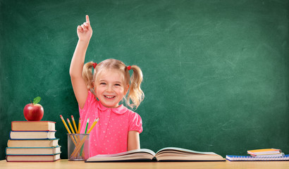 Happy Girl Raising Hand In The Classroom