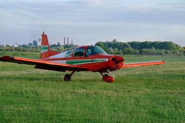Ultralight airplane on the airfield.