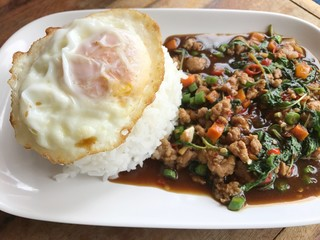 rice topped with stir-fried pork and basil.