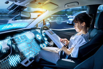 young woman reading a magazine in a autonomous car. driverless car. self-driving vehicle. heads up display. automotive technology. right hand drive.