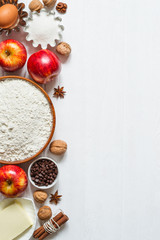 Ingredients for baking on white wooden background. Selection for apple pie or cupcakes