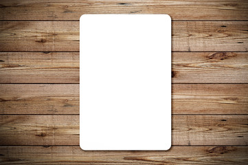 Top view of blank paper page on wood background office desk with different objects. Minimal flat lay style