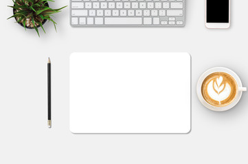 Modern workplace with notebook, smartphone, blank paper, coffee up, pencil and little tree copy space on gray background. Top view. Flat lay style. Wall mural