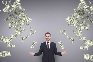 Happy business man with money rain against purple background
