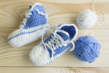Knitted booties for newborns. Creative knitting.