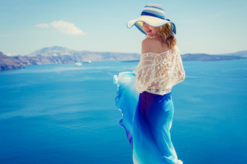 Woman in blue skirt by the sea