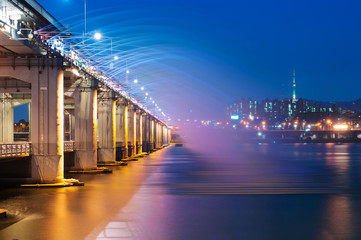 Banpo bridge rainbow fountain show at night in Seoul, Soth Korea.