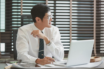 Businessman working at office with laptop.