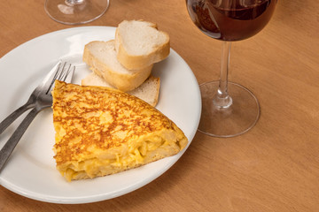 Spanish tortilla with wine, tapas in local bar