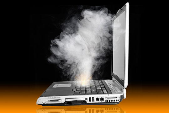 Laptop computer overheated and caught fire, emmiting cloud of smoke, needs repair support and service